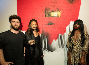 "(L-R) Artist Roy Nachum, singer Rihanna, and poet Chloe Mitchell at Rihanna's 8th album artwork reveal for ""ANTI"" at MAMA Gallery on October 7, 2015 in Los Angeles, California"