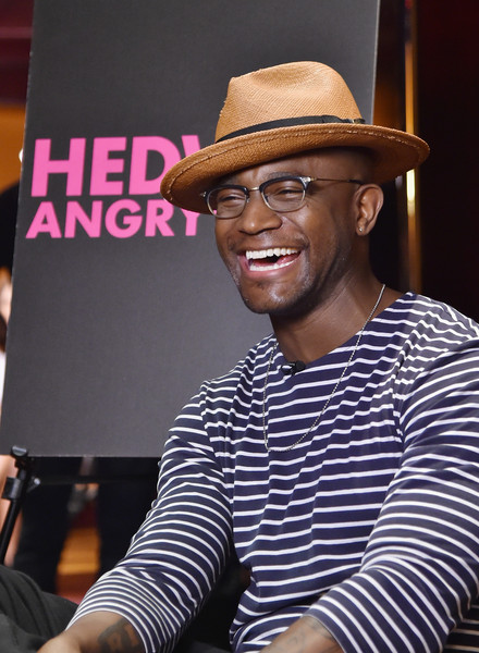 """Taye Diggs poses for a picture at Broadway's """"Hedwig And The Angry Inch"""" Cast Photocall at The Lambs Club on June 30, 2015 in New York City."""