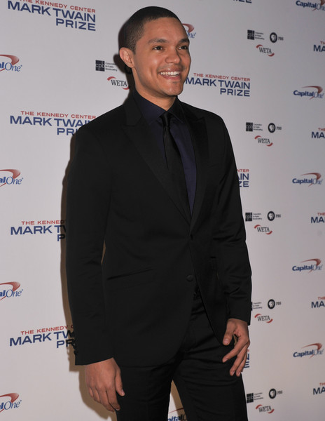 Host of the Daily Show Trevor Noah poses on the red carpet during the 18th Annual Mark Twain Prize For Humor honoring Eddie Murphy at The John F. Kennedy Center for Performing Arts on October 18, 2015 in Washington, DC