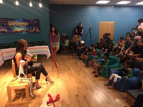 "Tamera Mowry Housely reading ""Goosebumps"" at the Inglewood Public Library"