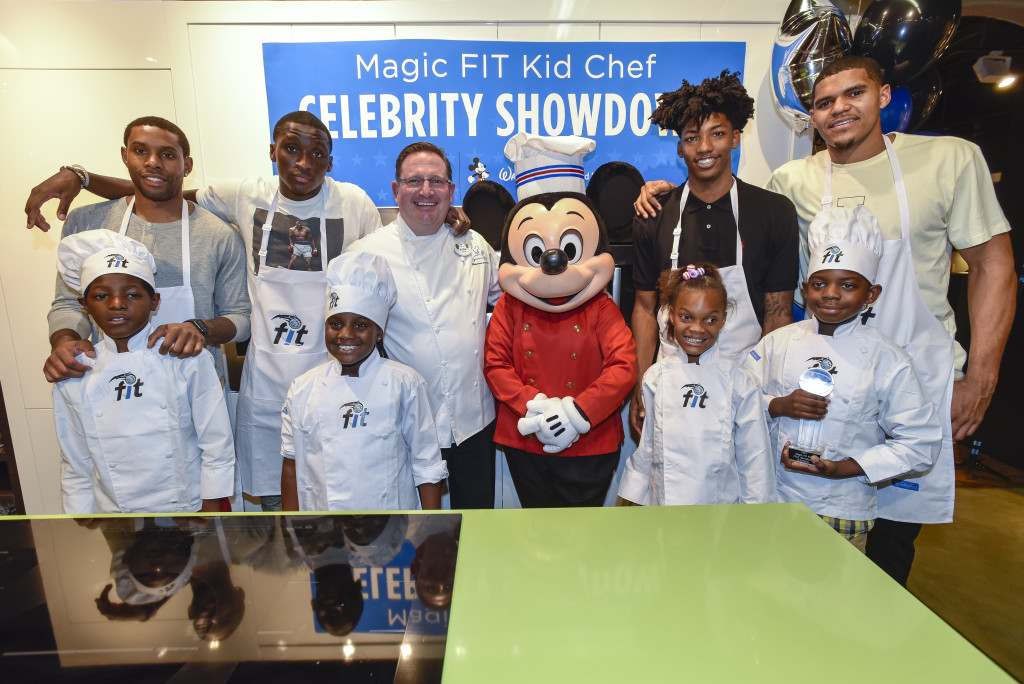 Orlando Magic players C.J. Watson, Victor Oladipo, Chef Charles Dodson, Disney's Mickey, Elfrid Payton, and Tobias Harris with Kid Chefs for the Magic FIT Kid Chef Celebrity Showdown at Aggressive Appliances ©2015 Fernando Medina/Orlando Magic