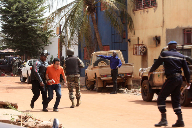 A hostage, second from left, was evacuated to safety from the Radisson Blu hotel in Bamako, Mali, on Friday.