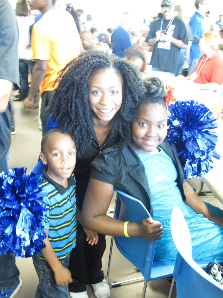 Orlando Magic Dancer Victoria R. poses with attendees of the event. Photo Credit: Yolanda Baruch