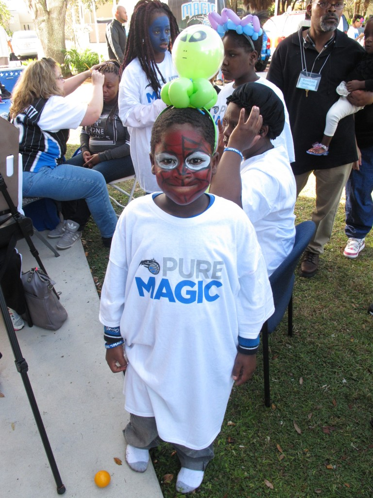 Attendee of the event gets his face painted. Photo Credit: Yolanda Baruch