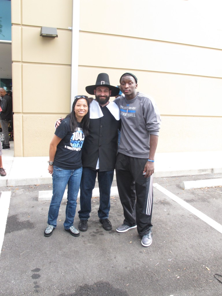 Representative from 104.5 The Beat,Matt Keller, Event Presentation Manager at the Orlando Magic, and Victor Oladipo.