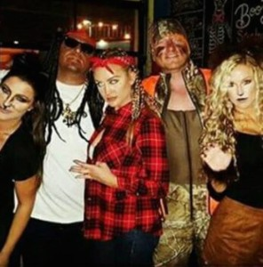 Jason Aldean (2nd from left) as Lil Wayne at a Halloween Party