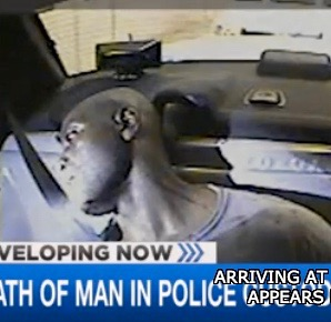 Linwood Lambert is shown unconscious in the back of a police car in surveillance video