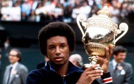 Arthur Ashe holds aloft the trophy after defeating Jimmy Connors at Wimbledon Mens Singles Final - 05-07-1975