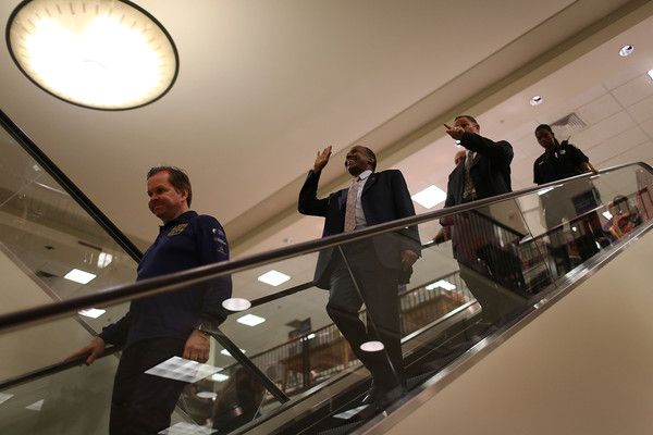 Republican presidential candidate Ben Carson waves goodbye as he leaves after a stop to sign his book at a Barnes and Noble store on November 5, 2015 in Fort Lauderdale Florida