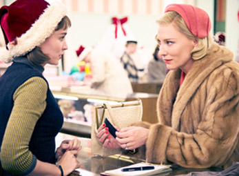 Rooney Mara (Therese) and Cate Blanchett (Carol) first encounter in 'Carol.'