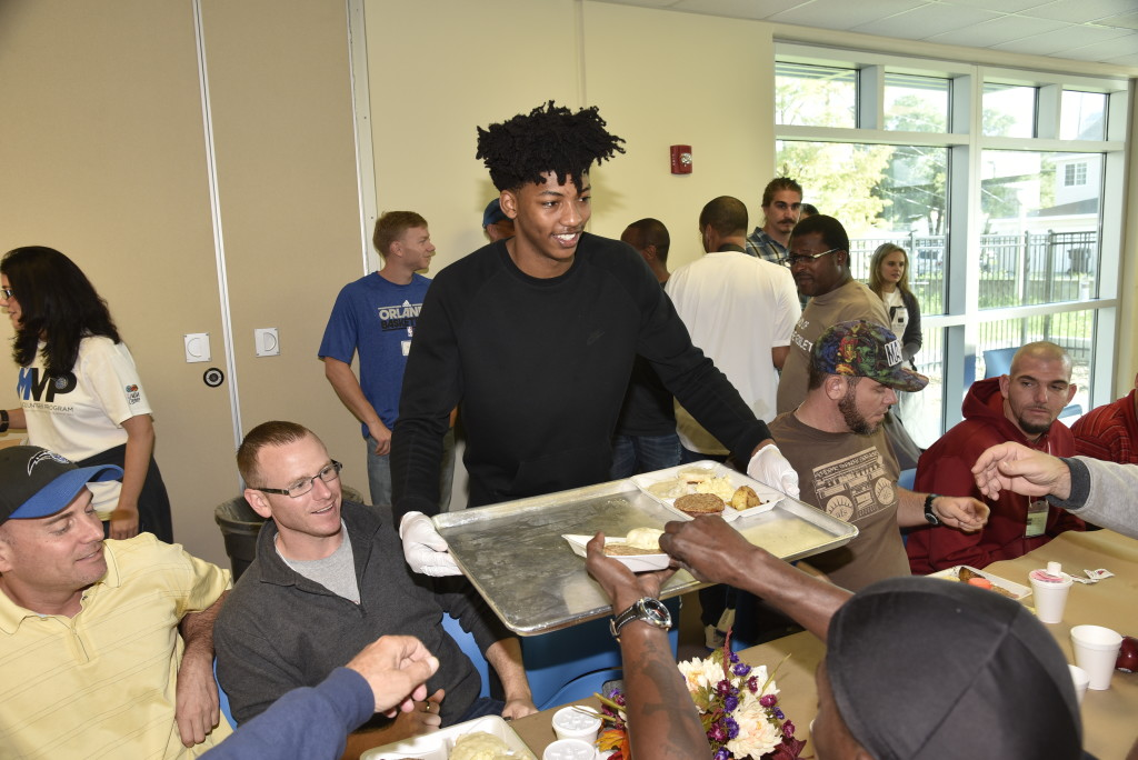 Magic guard Elfrid Payton serves the residents breakfast at the Coalition for the Homeless on Thanksgiving day. Photo Credit: Gary Bassing, Orlando Magic.