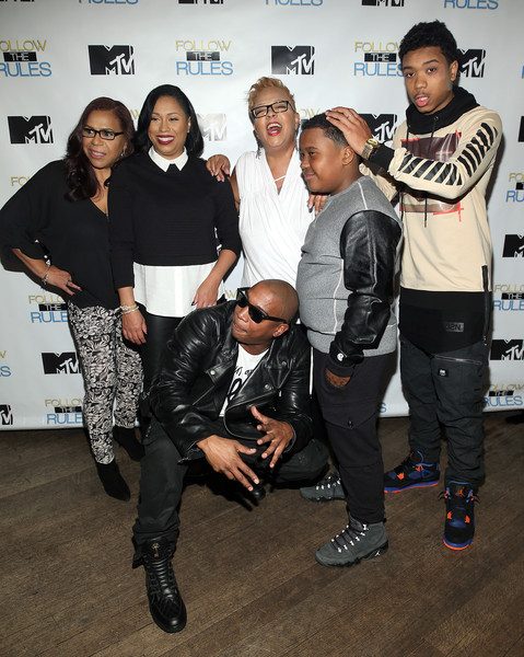 """(L-R) Irma Murray, Aisha Atkins, Debra Atkins, Jorden Atkins, Jeff Atkins Jr. and rapper Ja Rule (front) attend the MTV And Ja Rule: """"Follow The Rules"""" Premiere Party at Catch on October 21, 2015 in New York City."""