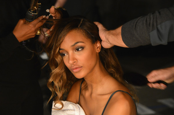 Model Jourdan Dunn prepares backstage at the BALMAIN X H&M Collection Launch at 23 Wall Street on October 20, 2015 in New York City.