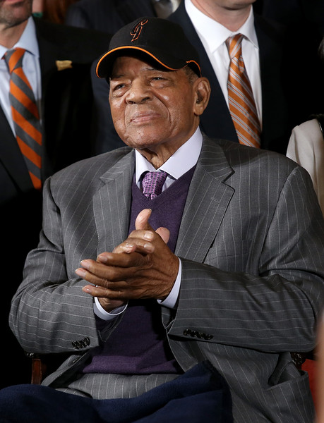 Baseball Hall of Famer Willie Mays applauds as U.S. President Barack Obama welcomes the World Series Champion San Francisco Giants to the White House June 4, 2015 in Washington, DC.