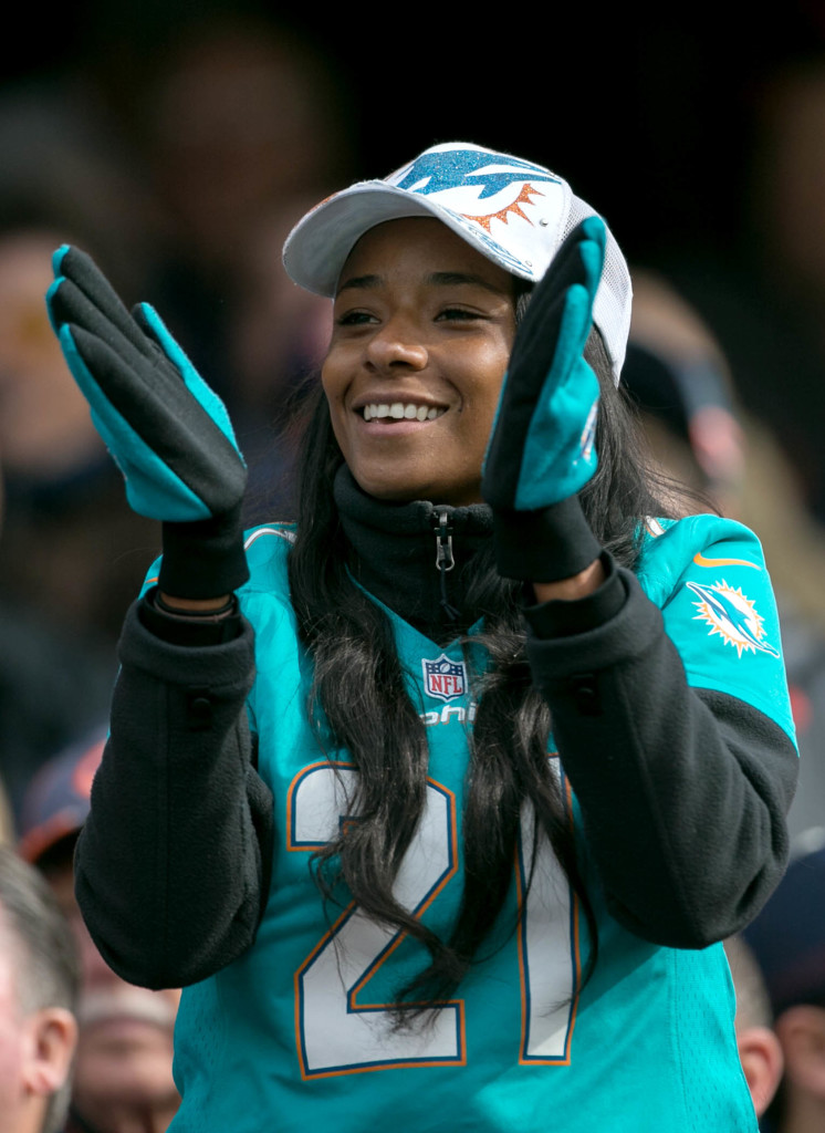 Miko Grimes applauds the action as the Dolphins hand the Bears a loss at Soldier Field in Chicago, Illinois on October 19, 2014.