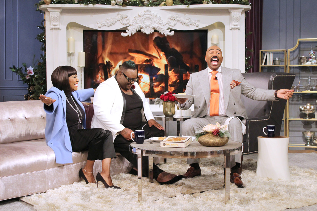 L TO R, Patti LaBelle, James Wright Chanel look on as Steve Harvey taste tests Patti's famed sweet potato pie.