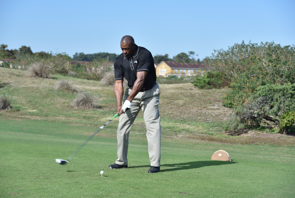 Former Magic player, and current Community Ambassador Nick Anderson prepares for his swing. Photo Credit: Gary Bassing.