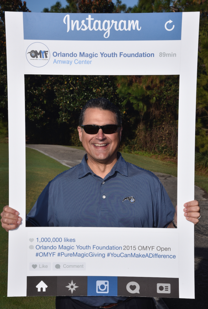 Magic CEO Alex Martins having a good time at the OMYF Golf Tourney. Photo Credit: Gary Bassing.