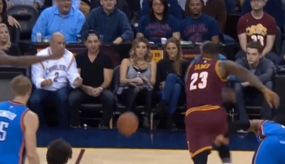 LeBron James heads for loose ball, and straight for Ellie Day (Center)