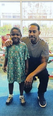 Ludacris with a young patient at Children's Hospital in Atlanta