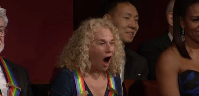 Carol King feeling the earth move...under her feet after Aretha Franklin is introduced at the 2015 Kennedy Center Honors in Washington