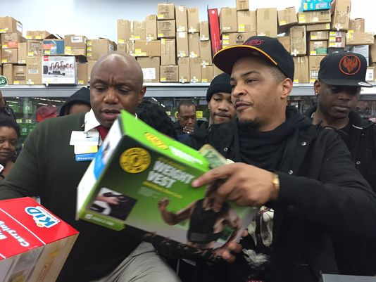 Atlanta rapper T.I. surprised shoppers at a West Atlanta Walmart on Christmas Eve and bought kids thousands in toys.