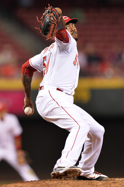 Aroldis Chapman #54 of the Cincinnati Reds pitches in the ninth inning against the New York Mets at Great American Ball Park on September 25, 2015 in Cincinnati, Ohio. New York defeated Cincinnati 12-5.