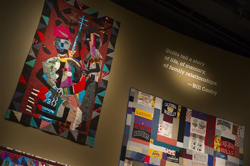 FILE - In this Nov. 6, 2014, file photo, quilts from the Bill and Camille Cosby collection hang at the Smithsonian's National Museum of African Art in Washington.