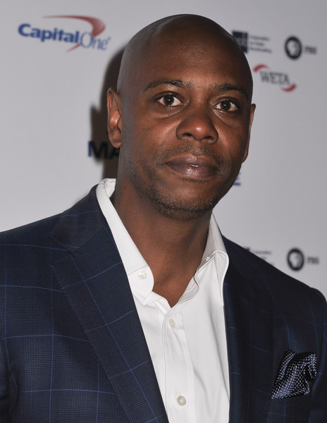WASHINGTON, DC- OCTOBER 18: Actress and comedian Dave Chappelle poses on the red carpet during the 18th Annual Mark Twain Prize For Humor honoring Eddie Murphy at The John F. Kennedy Center for Performing Arts on October 18, 2015 in Washington, DC.