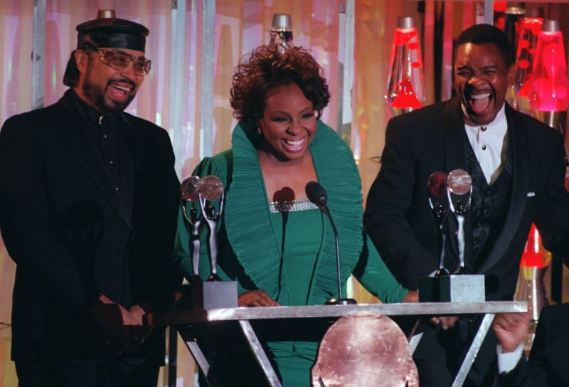 In this Jan. 17, 1996, file photo, Gladys Knight, center, William Guest, left, and Merald Knight take the stage as they are inducted into the Rock and Roll Hall of Fame during ceremonies in New York