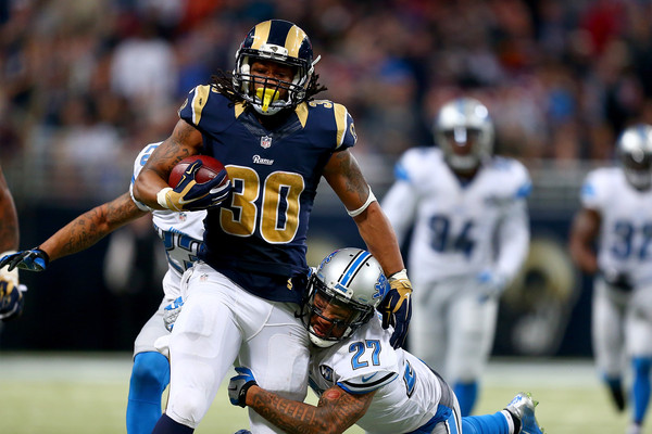 Glover Quin tries to tackle Todd Gurley #30 of the St. Louis Rams as he carries the ball in the third quarter at the Edward Jones Dome on December 13, 2015 in St. Louis, Missouri.