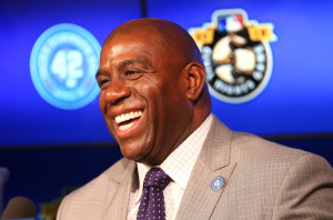 Dodgers owner Magic Johnson smiles at a press conference before the Jackie Robinson Day game between the Seattle Mariners and the Los Angeles Dodgers at Dodger Stadium on April 15, 2015 in Los Angeles, California. All Major League Baseball players are wearing #42 today in honor of Jackie Robinson Day.