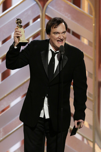 """In this handout photo provided by NBCUniversal, Quentin Tarantino accepts the award for Best Original Score - Motion Picture for """"The Hateful Eight"""" during the 73rd Annual Golden Globe Awards at The Beverly Hilton Hotel on January 10, 2016 in Beverly Hills, California."""
