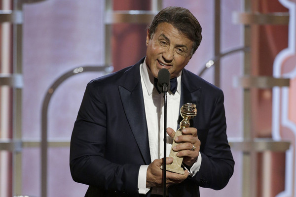 """In this handout photo provided by NBCUniversal, Sylvester Stallone accepts the award for Best Supporting Actor - Motion Picture for """"Creed"""" onstage during the 73rd Annual Golden Globe Awards at The Beverly Hilton Hotel on January 10, 2016 in Beverly Hills, California."""