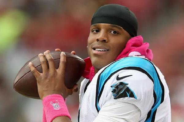 cam newton (with football)