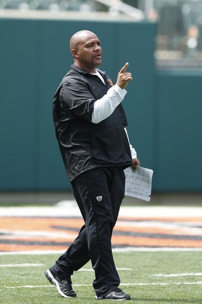Offensive coordinator Hue Jackson of the Cincinnati Bengals looks on during an organized team activity (OTA) workout at Paul Brown Stadium on June 3, 2014 in Cincinnati, Ohio.