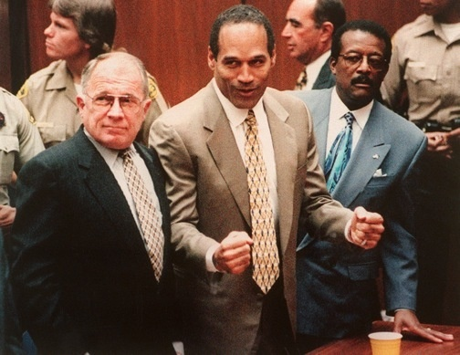 LOS ANGELES, CA - OCTOBER 3: US murder murder defendant O.J Simpson (C) celebrates the not guilty verdict with his attorney F.Lee Bailey (L) and Johnnie Cochan Jr (R). Simpson was found not guilty of killing his ex-wife Nicole Brown-Simpson and her friend Ron Goldman. (Photo credit should read AFP/AFP/Getty Images)
