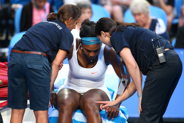 Serena Williams of the United States talks with Player Services staff prior to withdrawing from her singles match against Jarmila Wolfe of Australia Gold with a knee in jury during day three of the 2016 Hopman Cup at Perth Arena on January 5, 2016 in Perth, Australia.