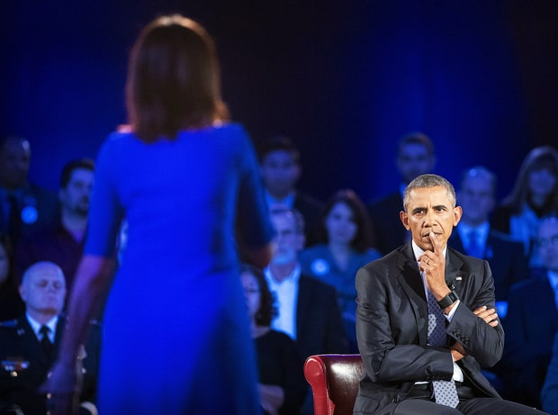 President Barack Obama, right, listens to a question from Taya Kyle, left, widow of U.S. Navy SEAL Chris Kyle, during a CNN-televised town hall meeting hosted by Anderson Cooper at George Mason University in Fairfax, Va., Thursday, Jan. 7, 2016