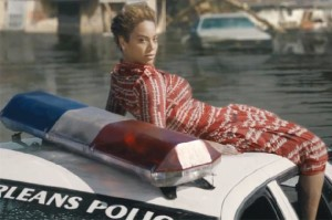 beyonce (on top of police car)