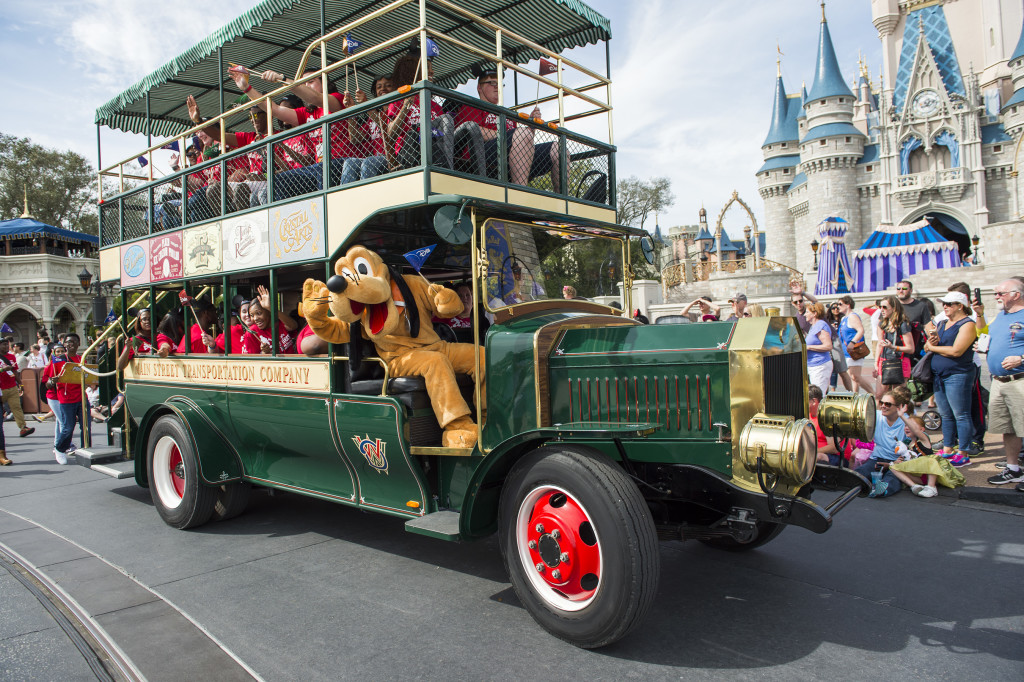 The 2016 Disney Dreamers join Mickey Mouse's sidekick Pluto in a special parade saluting Disney Dreamers Academy. (Ryan Wendler, photographer)