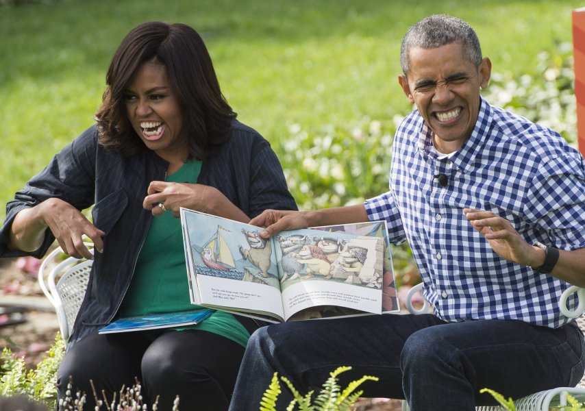 "US President Barack Obama and First Lady Michelle Obama read the book, ""Where the Wild Things Are,"" during the annual Easter Egg Roll on the South Lawn of the White House in Washington, DC, March 28, 2016. Some 35,000 guests have been invited to participate in the 138th annual Easter Egg roll. The theme of the day's event is Let's Celebrate! / AFP / SAUL LOEB (Photo credit should read SAUL LOEB/AFP/Getty Images)"