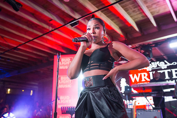 Ashanti takes the stage with The Roots at the Bud Light Factory during the Bud Light Music Showcase on March 19, 2016 in Austin, Texas.