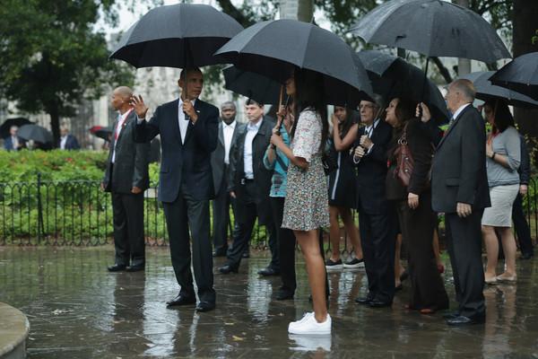 U.S. President Barack Obama (2nd L) his daughter Malia (C), 17, and and other members of the first family pause to look at a statue of Cuban independence hero Carlos Manuel de Cespedes during a walking tour of in the plaza of the 18th century Catedral de San Cristobal de la Habana in the historic Old Havana neighborhood March 20, 2016 in Havana, Cuba.