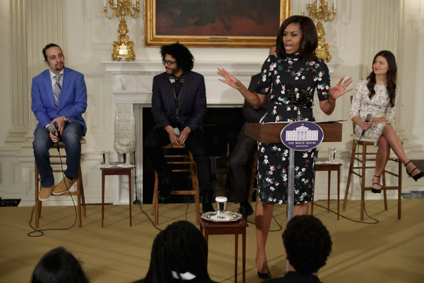 first lady Michelle Obama (C) delivers remarks while welcoming the Broadway cast of HAMILTON, including (L-R) Lin-Manuel Miranda, Daveed Diggs and Phillipa Soo, to the White House March 14, 2016 in Washington, DC.
