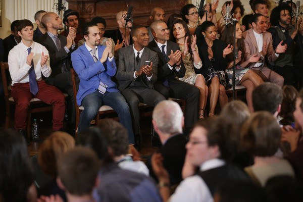 Members of the Broadway cast of 'Hamilton,' including creator and star Lin-Manuel Miranda (in blue jacket), applaud for educators before performing music from the production for President Barack Obama, first lady Michelle Obama and other guests in the East Room of the White House March 14, 2016 in Washington, DC.