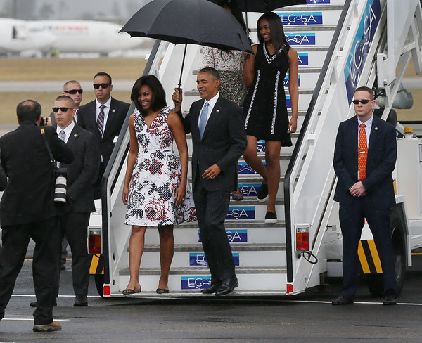 First lady Michelle Obama, President Barack Obama, Malia Obama and Sasha Obama arrive at Jose Marti International Airport for a 48-hour visit on Airforce One March 20, 2016 in Havana, Cuba.