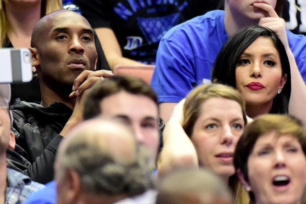Kobe Bryant and wife Vanessa Bryant watch the Duke Blue Devils take on the Oregon Ducks in the 2016 NCAA Men's Basketball Tournament West Regional at the Honda Center on March 24, 2016 in Anaheim, California.