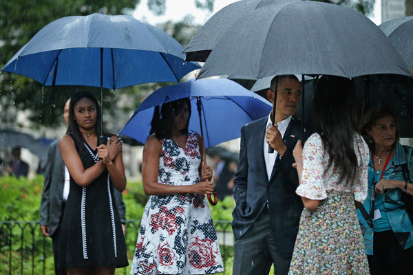 (L-R) Sasha Obama, 14, first lady Michelle Obama, U.S. President Barack Obama and Malia Obama, 17, pause to look at a statue of Cuban independence hero Carlos Manuel de Cespedes during a walking tour of the plaza of the 18th century Catedral de San Cristobal de la Habana in the Old Havana neighborhood March 20, 2016 in Havana, Cuba.