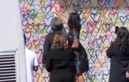 Michelle Obama tagging a wall in Washington D.C.